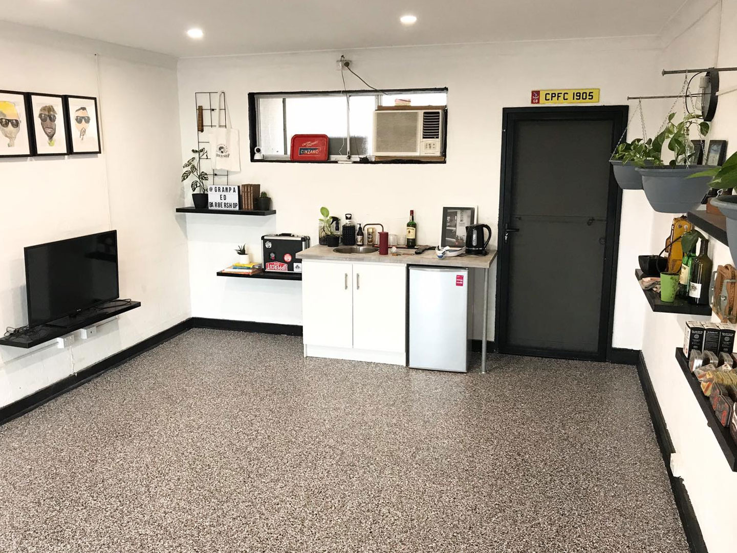 grandpa-ed-barber-epoxy-flooring-after-gallery-stripproof-industries